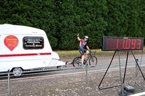Endurance cyclist Mark Beaumont tows a caravan with his bicycle!