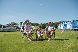 Family on caravan site holidaying at Bridge Leisure Parks