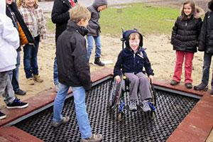 Children play on Inclusive Play Equipment From Huck